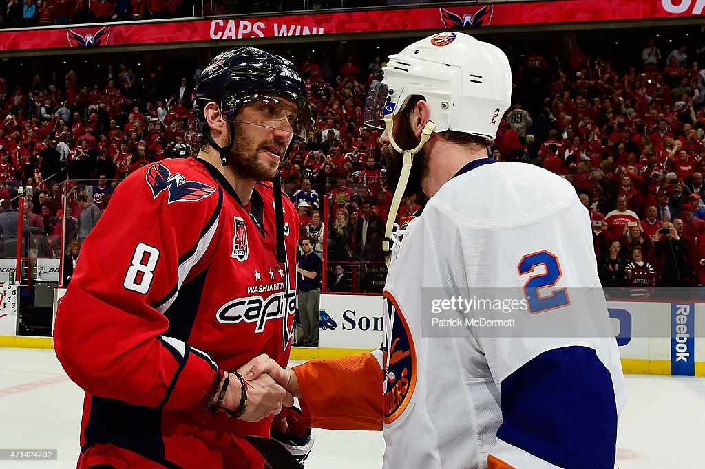 Alex Ovechkin #8 of the Washington Capitals and Nick Leddy #2 of the New York Islanders shake hands following the Capitals victory over the Islanders in Game Seven of the Eastern Conference Quarterfinals during the 2015 NHL Stanley Cup Playoffs at Verizon Center on April 27, 2015 in Washington, DC. The Capitals defeated the Islanders 2-1 to win the series 4 games to 3.