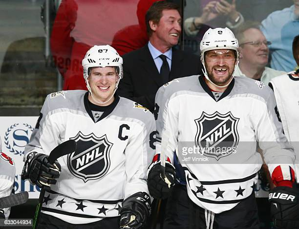 Alex Ovechkin of the Washington Capitals and Sidney Crosby of the Pittsburgh Penguins react from the bench area during the Metropolitan Division and...
