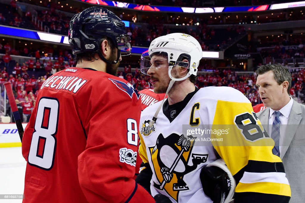 Alex Ovechkin #8 of the Washington Capitals and Sidney Crosby #87 of the Pittsburgh Penguins shake hands after the Penguins defeated the Capitals 2-0 in Game Seven of the Eastern Conference Second Round during the 2017 NHL Stanley Cup Playoffs at Verizon Center on May 10, 2017 in Washington, DC.