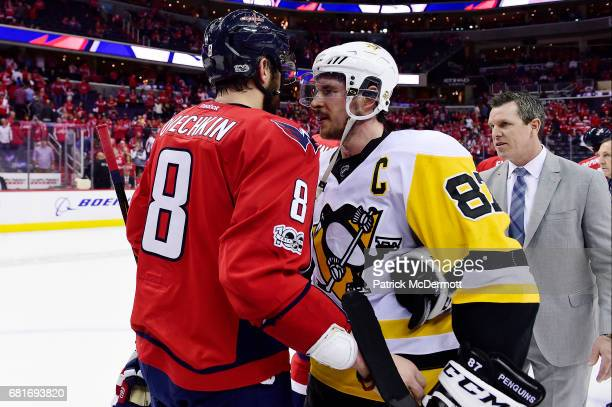 Alex Ovechkin of the Washington Capitals and Sidney Crosby of the Pittsburgh Penguins shake hands after the Penguins defeated the Capitals 20 in Game...