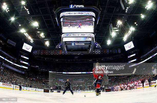 Alex Ovechkin of the Washington Capitals and Team Foligno reacts during the 2015 Honda NHL AllStar Skills Competition at the Nationwide Arena on...