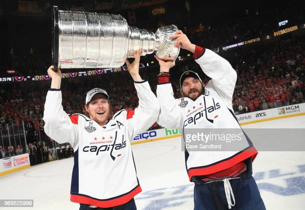 Alex Ovechkin of the Washington Capitals and teammate Nicklas Backstrom lift the Stanley Cup as they celebrate after their team defeated the Vegas...