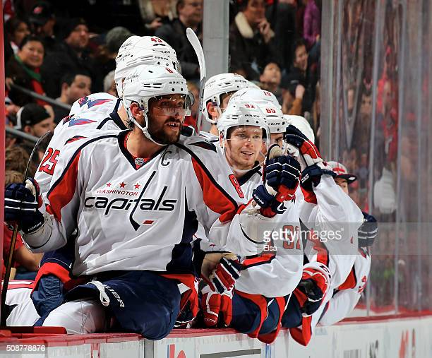 Alex Ovechkin of the Washington Capitals and the rest of the bench celebrates teammate Paul Carey's goal in the third period against the New Jersey...