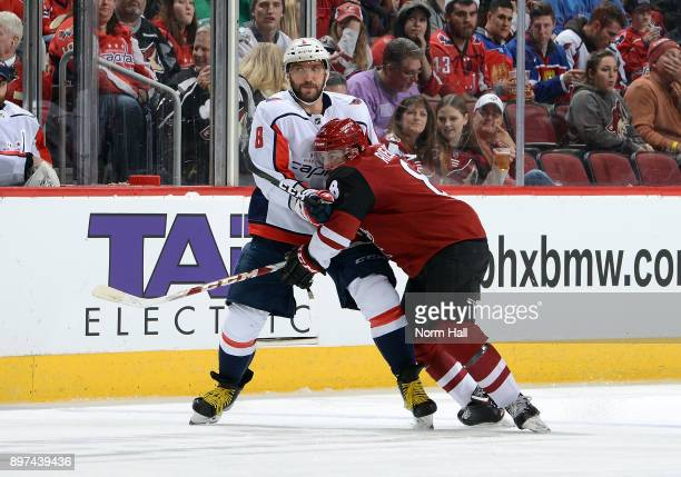 Alex Ovechkin of the Washington Capitals and Tobias Rieder of the Arizona Coyotes battle for position during the second period at Gila River Arena on...
