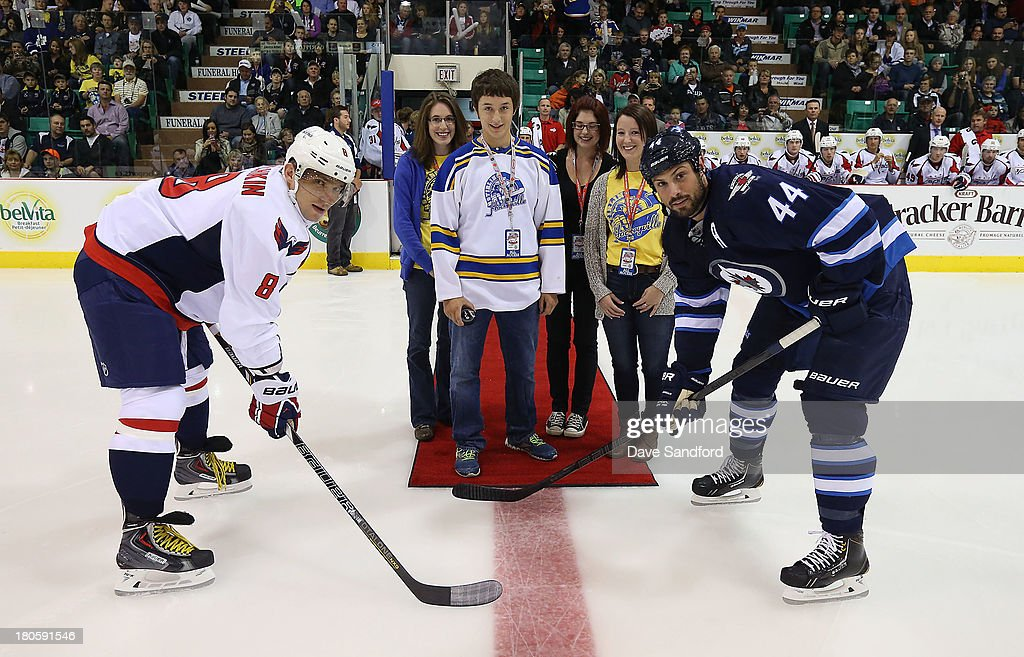 Alex Ovechkin #8 of the Washington Capitals and Zach Bogosian #44 of the Winnipeg Jets take part in a ceremonial face-off during Kraft Hockeyville Day 2 at Yardman Arena on September 14, 2013 in Belleville, Ontario, Canada.