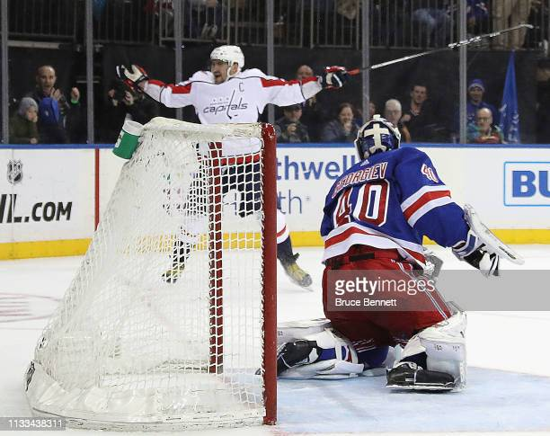 Alex Ovechkin of the Washington Capitals argues with the referee as Alexandar Georgiev of the New York Rangers let go of his goalie stick during the...