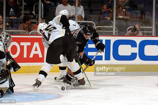 Alex Ovechkin of the Washington Capitals battles against Daniel Fernholm of the Pittsburgh Penquins during an exhibition game on September 30 2005 at...