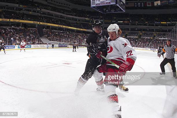 Alex Ovechkin of the Washington Capitals battles for the puck against Mike Commodore of the Carolina Hurricanes at the Verizon Center on April 5 2006...