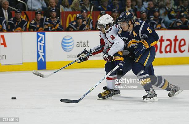 Alex Ovechkin of the Washington Capitals battles past Toni Lydman of the Buffal Sabres in a game on October 13 2007 at the HSBC Arena in Buffalo...
