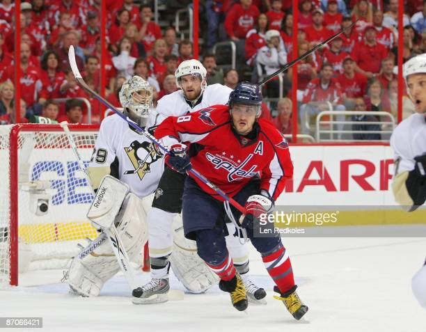 Alex Ovechkin of the Washington Capitals battles with Philippe Boucher of the Pittsburgh Penguins during Game Five of the Eastern Conference...