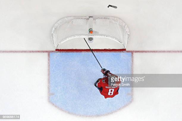 Alex Ovechkin of the Washington Capitals breaks his stick over the crossbar of the goal after Tampa Bay Lightning scored an empty net goal during the...