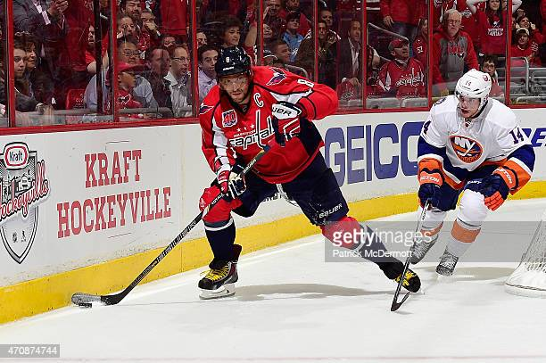 Alex Ovechkin of the Washington Capitals brings the puck around the net against Thomas Hickey of the New York Islanders during the second period in...