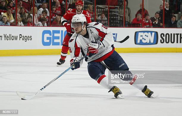 Alex Ovechkin of the Washington Capitals carries the puck during the NHL game against ther Carolina Hurricanes on March 25 2008 at RBC Center in...
