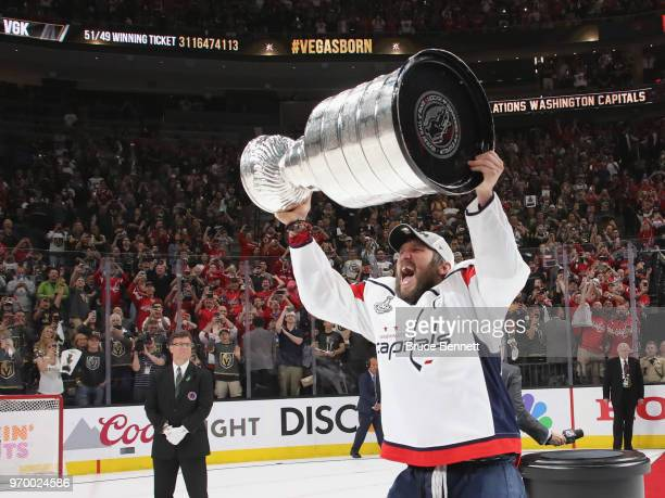 Alex Ovechkin of the Washington Capitals carries the Stanley Cup in celebration after his team defeated the Vegas Golden Knights 43 in Game Five of...