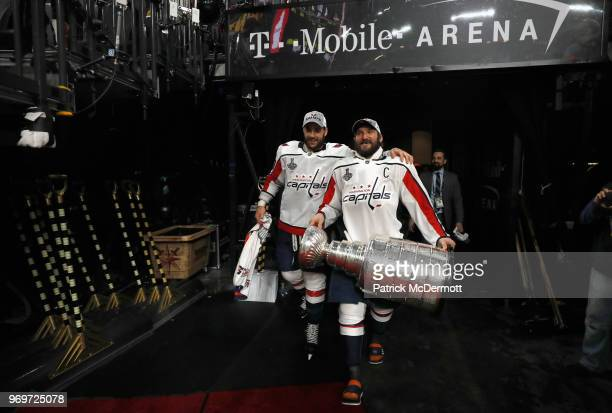 Alex Ovechkin of the Washington Capitals carries the Stanley Cup next to teammate Tom Wilson after the Capitals defeated the Vegas Golden Knights 43...