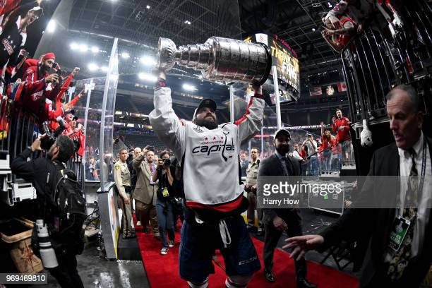 Alex Ovechkin of the Washington Capitals carries the Stanley Cup off the ice after his team defeated the Vegas Golden Knights 43 in Game Five of the...