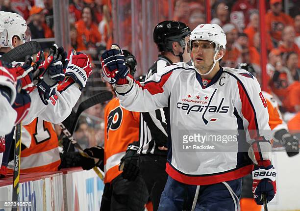Alex Ovechkin of the Washington Capitals celebrates a first period goal against the Philadelphia Flyers by teammate Marcus Johansson in Game Three of...