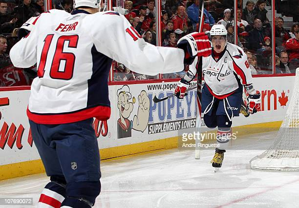 Alex Ovechkin of the Washington Capitals celebrates a goal by teammate Eric Fehr against the Ottawa Senators during second period action at...