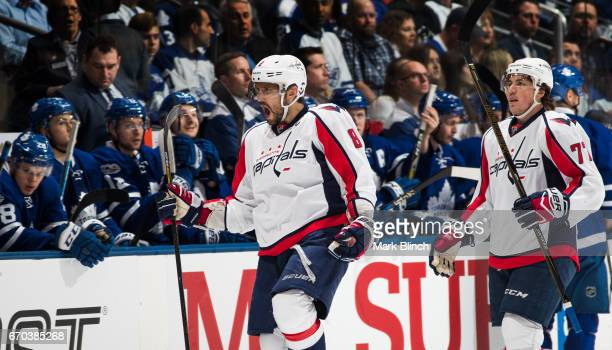 Alex Ovechkin of the Washington Capitals celebrates a goal by his teammate T.J. Oshie in front of the Toronto Maple Leafs bench during the first...