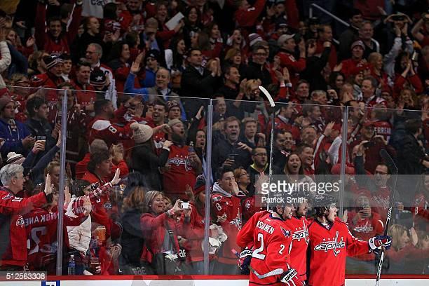 Alex Ovechkin of the Washington Capitals celebrates a goal with teammates TJ Oshie and Matt Niskanen against the Minnesota Wild during the third...