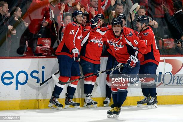 Alex Ovechkin of the Washington Capitals celebrates after Evgeny Kuznetsov scored his first career NHL goal in the third period during an NHL game...