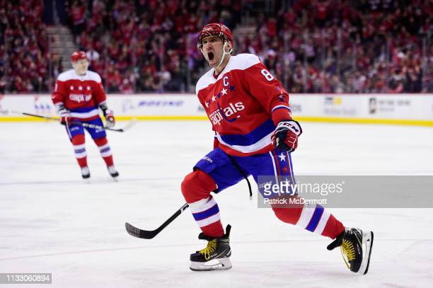 Alex Ovechkin of the Washington Capitals celebrates after scoring a goal in the third period against the Carolina Hurricanes at Capital One Arena on...