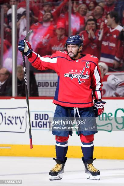 Alex Ovechkin of the Washington Capitals celebrates after scoring a goal in the third period against the Carolina Hurricanes in Game Five of the...