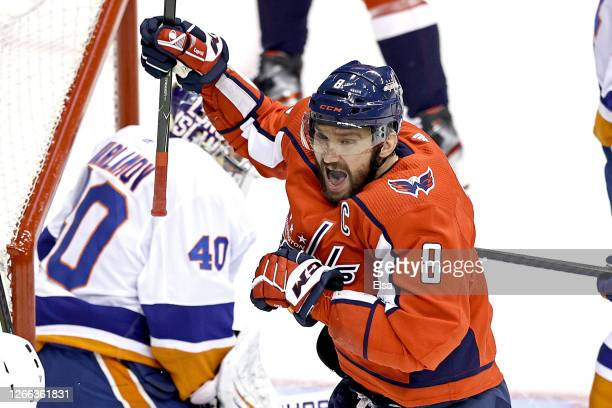 Alex Ovechkin of the Washington Capitals celebrates after scoring a goal past Semyon Varlamov of the New York Islanders during the first period in...