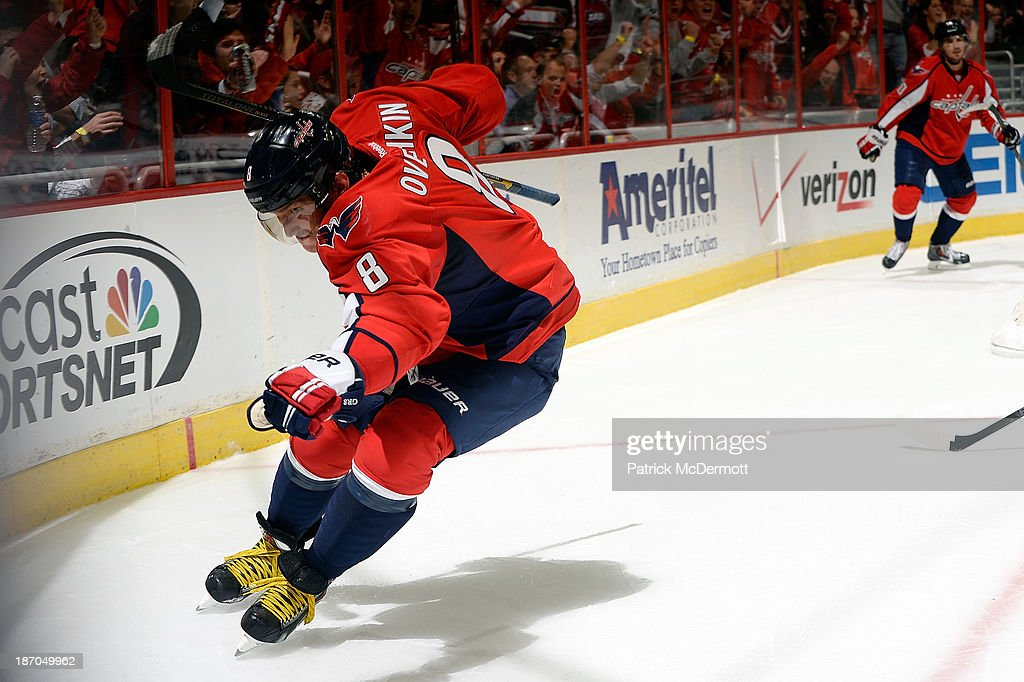 Alex Ovechkin #8 of the Washington Capitals celebrates after scoring a goal in the second period of an NHL game against the New York Islanders at Verizon Center on November 5, 2013 in Washington, DC.