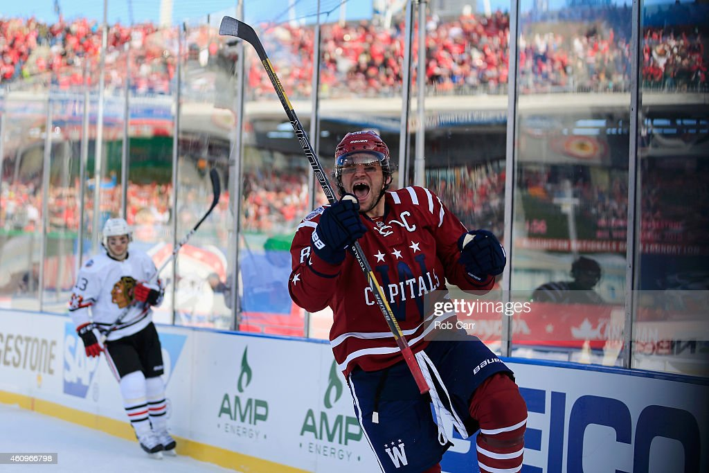 Alex Ovechkin #8 of the Washington Capitals celebrates after scoring a first period goal against the Chicago Blackhawks during the 2015 NHL Winter Classic at Nationals Park on January 1, 2015 in Washington, DC.