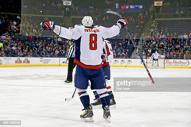 Alex Ovechkin of the Washington Capitals celebrates after scoring a goal during the first period of the game against the Columbus Blue Jackets on...