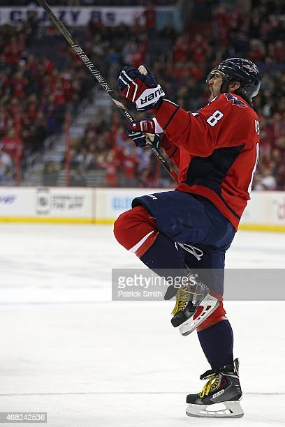 Alex Ovechkin of the Washington Capitals celebrates after scoring a goal against the Carolina Hurricanes in the first period at Verizon Center on...