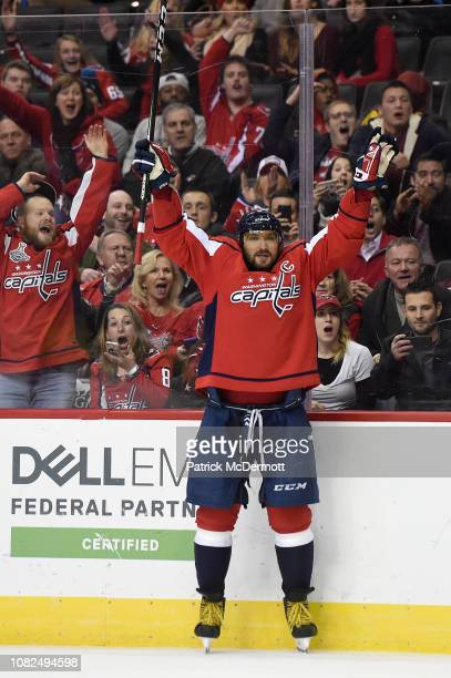Alex Ovechkin of the Washington Capitals celebrates after scoring his third goal of the game for a hat trick in the third period against the Detroit...