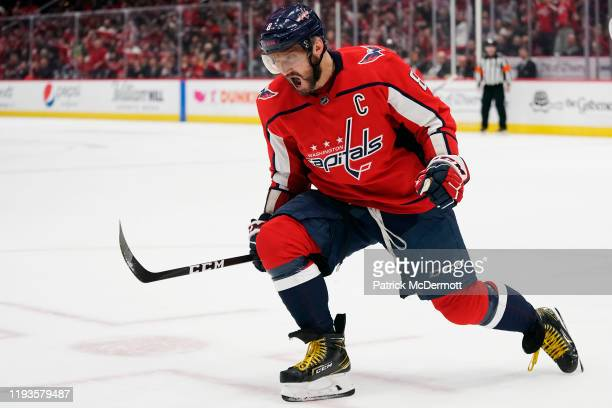 Alex Ovechkin of the Washington Capitals celebrates after scoring his first goal of the game against the Carolina Hurricanes in the first period at...