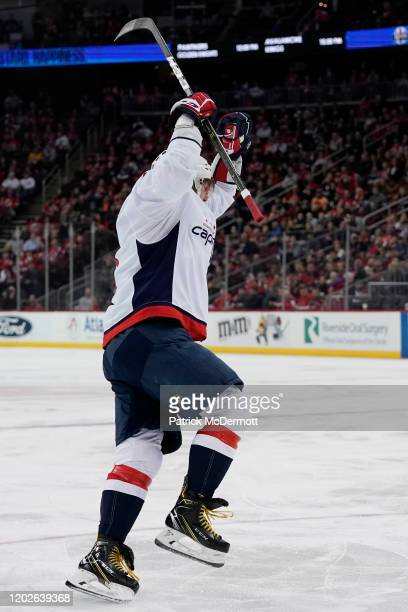 Alex Ovechkin of the Washington Capitals celebrates after scoring his 700th career NHL goal in the third period against the New Jersey Devils at...