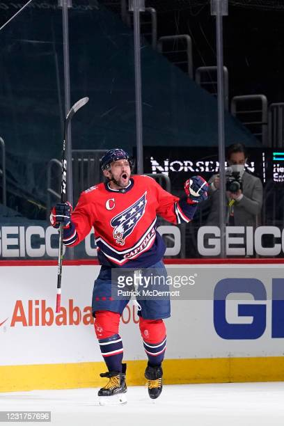 Alex Ovechkin of the Washington Capitals celebrates after scoring his 718th career NHL goal in the second period against the New York Islanders at...