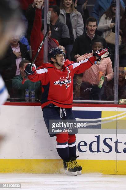 Alex Ovechkin of the Washington Capitals celebrates after scoring his 600th career goal against the Winnipeg Jets during the second period at Capital...