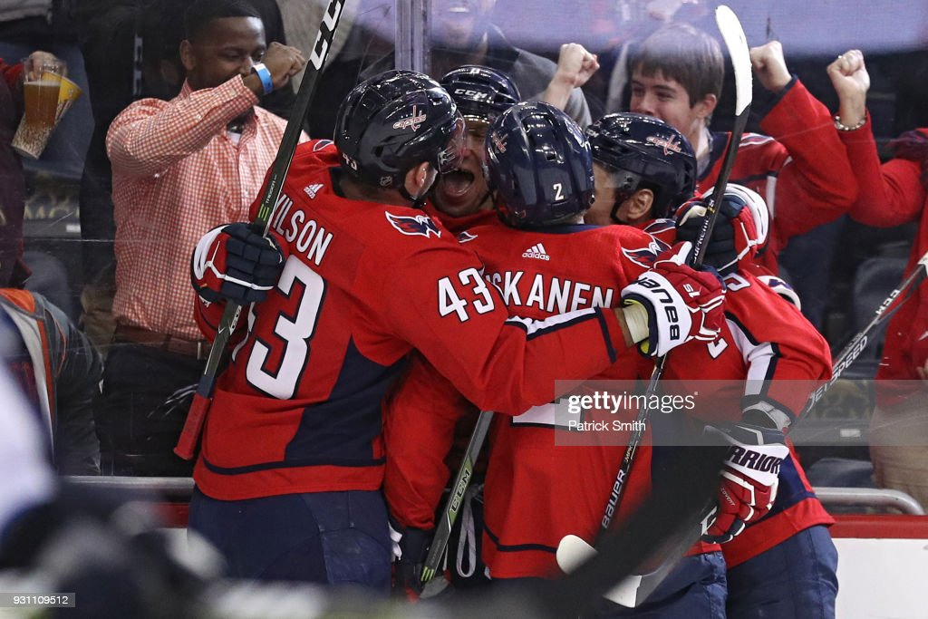 Alex Ovechkin #8 of the Washington Capitals celebrates after scoring his 600th career goal against the Winnipeg Jets during the second period at Capital One Arena on March 12, 2018 in Washington, DC.
