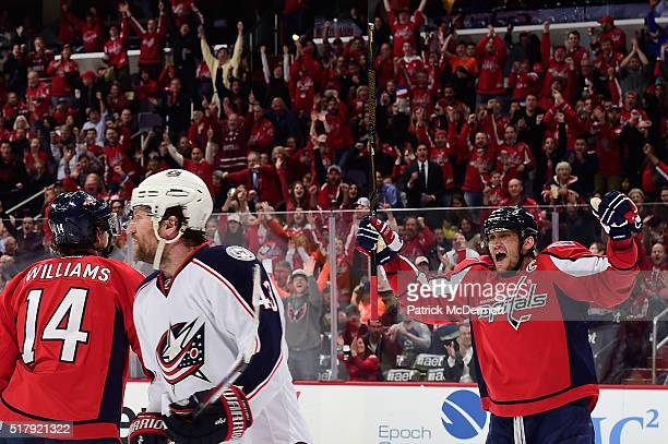 Alex Ovechkin of the Washington Capitals celebrates after teammate Justin Williams scored a goal in the first period during their game against the...