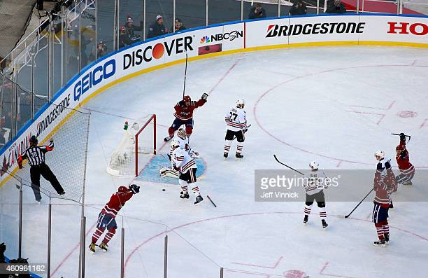 Alex Ovechkin of the Washington Capitals celebrates after Troy Brouwer scores on goaltender Corey Crawford of the Chicago Blackhawks late in the...