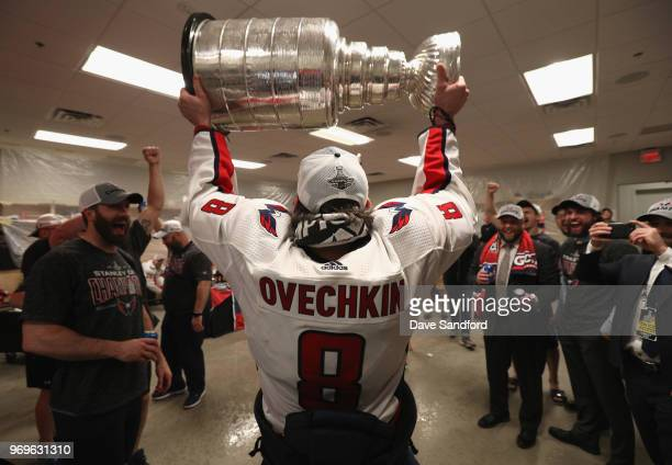 Alex Ovechkin of the Washington Capitals celebrates as he brings the Stanley Cup into the locker room after the Capitals defeated the Vegas Golden...