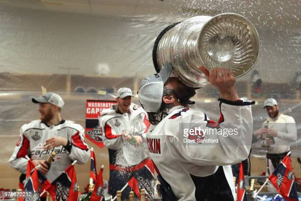 Alex Ovechkin of the Washington Capitals celebrates by kissing the Stanley Cup in the locker room after his team defeated the Vegas Golden Knights 43...