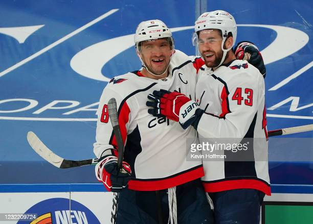 Alex Ovechkin of the Washington Capitals celebrates his goal against the Buffalo Sabres with Tom Wilson during the first period at KeyBank Center on...