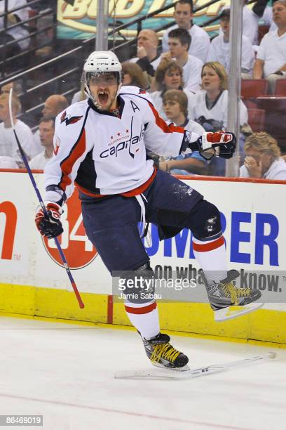 Alex Ovechkin of the Washington Capitals celebrates his goal as he skates past the stick of goaltender MarcAndre Fleury of the Pittsburgh Penguins in...