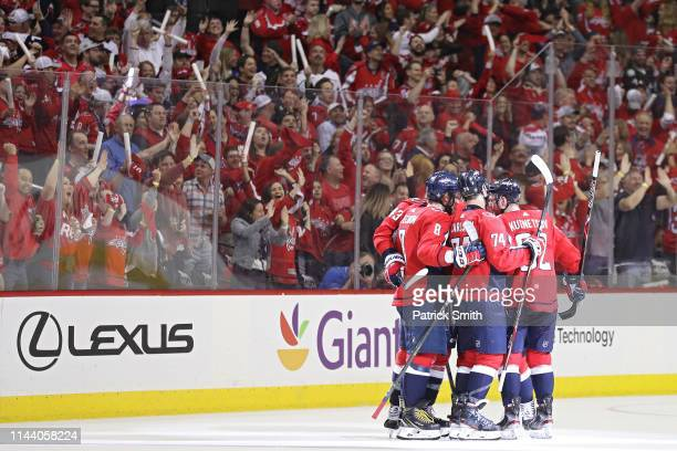 Alex Ovechkin of the Washington Capitals celebrates his goal with teammates against the Carolina Hurricanes in the third period in Game Five of the...
