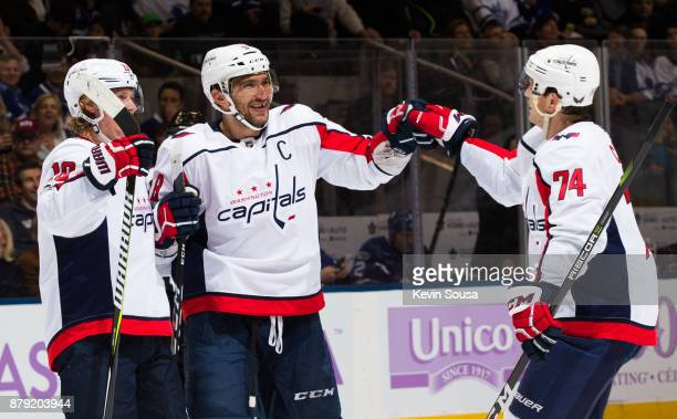 Alex Ovechkin of the Washington Capitals celebrates his second goal on the Toronto Maple Leafs with teammates Nicklas Backstrom and John Carlson...