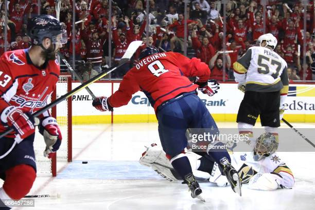 Alex Ovechkin of the Washington Capitals celebrates his secondperiod goal as MarcAndre Fleury of the Vegas Golden Knights reacts in Game Three of the...