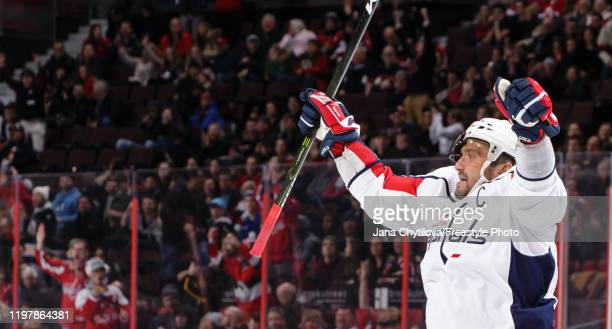 Alex Ovechkin of the Washington Capitals celebrates his third period emptynet goal moving him past Mark Messier into 8th on the alltime NHL goals...