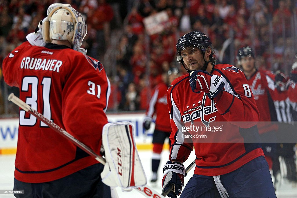 Alex Ovechkin #8 of the Washington Capitals celebrates his third period goal with goalie Philipp Grubauer #31 against the Dallas Stars at Verizon Center on November 19, 2015 in Washington, DC. With the goal, Ovechkin became the leader in career goals by a Russian-born player with his 484th career goal.