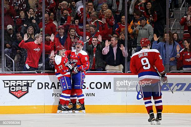 Alex Ovechkin of the Washington Capitals celebrates his third period goal with teammate TJ Oshie against the Buffalo Sabres at Verizon Center on...